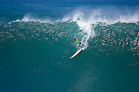 """WAIMEA BAY, Oahu/Hawaii (Tuesday, December 8, 2009) Bruce Irons (HAW) - The Quiksilver In Memory of Eddie Aikau,  was officially  called """"ON"""" by Contest Director George Downing this morning. The ASP specialty sanctioned event kicked off at 8am with wave face heights in the 25-35-foot range..Nine times world champion Kelly Slater (USA) led for most of the day until Greg Long(USA) scored his best four scoring rides in the last heat of the day to over take Slater. Long scored a perfect 100 point wave late in the day to seal the first prize purse of $55,000. Slater was runner up with Sunny Garcia (HAW) in 3rd, defending champion Bruce Irons (HAW) 4th and Ramon Navarro (CHL)  in 5th place. Navarro won the Monster drop award for the biggest drop, also in the final heat of the day when wave faces were pushing 40' plus...The northern hemisphere winter months on the North Shore signal a concentration of surfing activity with some of the best surfers in the world taking advantage of swells originating in the stormy Northern Pacific. Notable North Shore spots include Waimea Bay, Off The Wall, Backdoor, Log Cabins, Rockpiles and Sunset Beach... Ehukai Beach is more  commonly known as Pipeline and is the most notable surfing spot on the North Shore. It is considered a prime spot for competitions due to its close proximity to the beach, giving spectators, judges, and photographers a great view...The North Shore is considered to be one the surfing world's must see locations and every December hosts three competitions, which make up the Triple Crown of Surfing. The three men's competitions are the Reef Hawaiian Pro at Haleiwa, the O'Neill World Cup of Surfing at Sunset Beach, and the Billabong Pipeline Masters. The three women's competitions are the Reef Hawaiian Pro at Haleiwa, the Gidget Pro at Sunset Beach, and the Billabong Pro on the neighboring island of Maui...Photo: Joliphotos.com"""