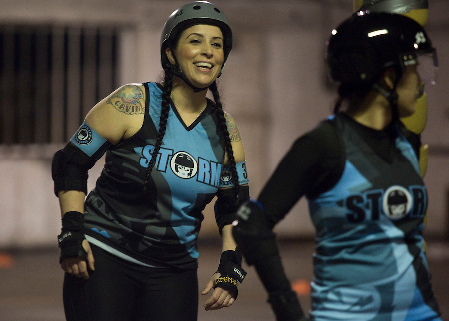 Dollie A. Troublemaker of the Storm City Roller Girls smiles as she practices in Vancouver Thursday February 9, 2017. (Photo by Natalie Behring for the Columbian)