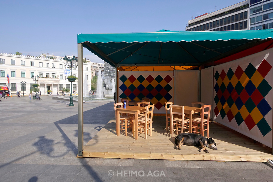 Athens, Greece. Opening days of documenta14.<br /> Kotzia Square. Installation by Rasheed Araeen: Shamiyaama - Food for Thought: Thought for Change, cooking and eating