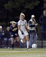 """Boston College forward Kristen Mewis (19) looks to cross ball for Boston College's first goal. Boston College defeated West Virginia, 4-0, in NCAA tournament """"Sweet 16"""" match at Newton Soccer Field, Newton, MA."""