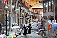 The Covered Market or Kapali Carsi in Bursa, Turkey. This is the central market area located near Ulu Cami and Koza Han. Originally an Ottoman area, the market traditionally specialised in silk but now sells jewellery, textiles, souvenirs and other merchandise. Bursa is situated in North West Anatolia and is the fourth largest city in Turkey. Picture by Manuel Cohen