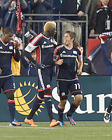 New England Revolution substitute midfielder Kelyn Rowe (11) celebrates his goal with teammates. In a Major League Soccer (MLS) match, the New England Revolution defeated Chicago Fire, 2-0, at Gillette Stadium on June 2, 2012.