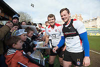 Jonathan Evans and Chris Cook of Bath Rugby sign autographs for supporters after the session. Bath Rugby Captain's Run on February 19, 2016 at the Recreation Ground in Bath, England. Photo by: Patrick Khachfe / Onside Images