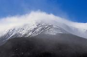 The eastern slopes of Mount Washington  engulfed in clouds and blowing snow during extreme winter weather conditions in the White Mountains, New Hampshire.