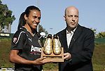 26 September 2010: FC Gold Pride's Marta (left) is presented with the Puma Golden Boot by Puma's Pat O'Brien (right) before the game. FC Gold Pride defeated the Philadelphia Independence 4-0 at Pioneer Stadium in Heyward, California in the Women's Professional Soccer championship game.