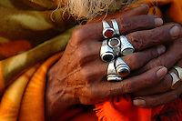 "India, Maharashtra, Nasik, 2007. In the soft light of early morning, the hands of a ""sadhu"" or holy man, relax in meditation."