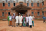 Heath care workers stand outside the United Methodist hospital in the Congolese village of Tunda.