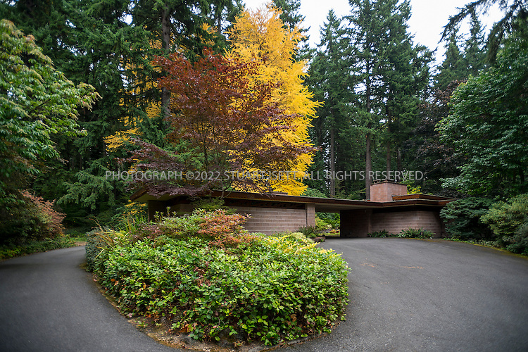 """10/9/2012--Sammamish, WA, USA..VIEW: Exterior showing car port...Architect Frank Lloyd Wright planned his """"Usonian"""" homes to be affordable for middle-class families. The 1,9500 square foot Brandes home is for sale in Sammamish, Washington (30 minutes from Seattle) at $1.39 million. It features three bedrooms, two bathrooms and a small, separate office/study space...The home was built in 1952, and has redwood trim and Wright's original furniture and some garden sculptures by Wright. It's one of only three Frank Lloyd Wright homes near Seattle...©2012 Stuart Isett. All rights reserved."""