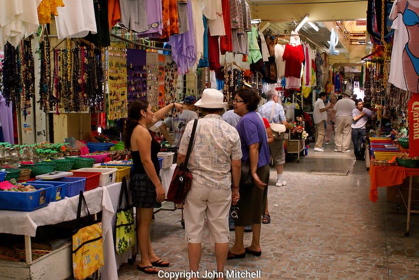 Tourists asking directions  in the Mercado Pino Suarez market, Mazatlan, Sinaloa, Mexico