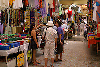 Tourists asking directions  in the Mercado Pino Suarez market, Mazatlan, Sinaloa, Mexico