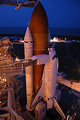 Kennedy Space Center, FL - July 4, 2006 -- After rollback of the rotating service structure (RSS) on Launch Pad 39B, Space Shuttle Discovery stands bathed in lights from the RSS and fixed service structure. The rollback was in preparation for launch on mission STS-121. Extending toward the cockpit of the shuttle is the orbiter access arm with the White Room extended. The White Room provides access into the orbiter for the astronauts. The RSS provides protected access to the orbiter for changeout and servicing of payloads at the pad. .Credit: Kim Shiflett - NASA via CNP.