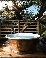 BNPS.co.uk (01202 558833)<br /> Pic: Mallinson/BNPS<br /> <br /> Outdoor hot tub in the treetops...<br /> <br /> Release your inner Tarzan...in Britain's poshest treehouse.<br /> <br /> A luxury glamping site in deepest Dorset has created a luxurious treehouse that comes with its own sauna, hot tub, rotating fireplace and pizza oven.<br /> <br /> The Woodsman's Treehouse is perched 30ft from the ground on long stilts and has two floors. <br /> <br /> It has a spiral staircase and a stainless steel slide for quick access to the ground and can be rented out from &pound;390 a night. <br /> <br /> It is located at the Crafty Camping glamping site at Holditch in west Dorset.