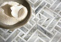 Delaunay, a hand-cut stone mosaic, shown in honed Cirrus and polished Dolomite, is part of the Palazzo collection by New Ravenna.