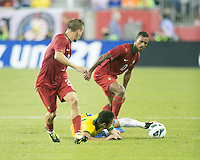 Brazil forward Neymar (10)  attempts to control the ball from the ground as Portugal defender Joao Pereira (21) and Portugal forward Nani (17) move in.  In an International friendly match Brazil defeated Portugal, 3-1, at Gillette Stadium on Sep 10, 2013.