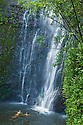 Wailua Falls, with two young women swimming in pool; Kipahulu, Hana Coast, Maui, Hawaii.