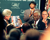 "United States President Bill Clinton receives the report ""One America in the 21st Century"" by The President's Initiative on Race from its Chairman, John Hope Franklin at the White House in Washington, D.C. on September 18, 1998..Credit: Ron Sachs / CNP"