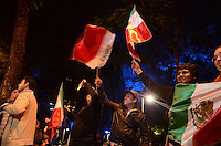 Mexico, DF November 20. 13. People hold up Mexican flags while they celebrate the victory of the Mexican National soccer Team 4-2 against New Zealand on the streets of Mexico City. Photo by Miguel Angel Pantaleon/VIEWpress