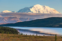 Evening light falls on the North face summit of Mt McKinley, North America's tallest mountain. Wonder lake in the foreground, Denali National Park, interior, Alaska.