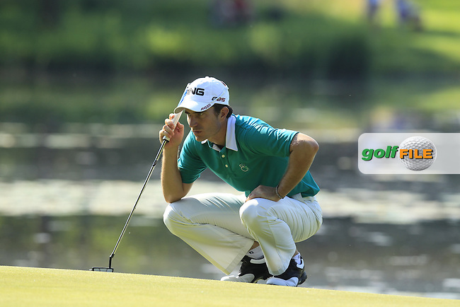 Alejandro Canizares (ESP) lines up his putt on the 16th green during Thursday's Round 1 of the 2013 BMW International Open held on the Eichenried Golf Club, Munich, Germany. 20th June 2013<br /> (Picture: Eoin Clarke www.golffile.ie)