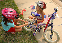 Two girls decorate their bikes before participating in the annual Fourth of July Celebration and community parade in Birkdale Village in Huntersville, NC. Birkdale Village combines the best of shopping, dining, apartments and entertainment venues within a 52-acre mixed-use development.