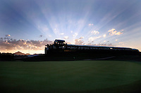 2 February 2007: 18th hole fairway early morning sunrise rises behind the stands sitting on the 18th green on the golf course at the FBR Open in Phoenix, AZ.