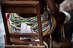 Beads adorn the waist of a Dipo-Yo (an adolescent girl undergoing Dipo). Beads are a form of wealth, handed down from mother to daughter through the generations, and each design has a particular significance. During Dipo, the number of beads worn by a girl is indicative of her family's wealth, as well as the strength of her relationship with them - if she is seen to be respectful older relatives will pitch in and lend her their beads.