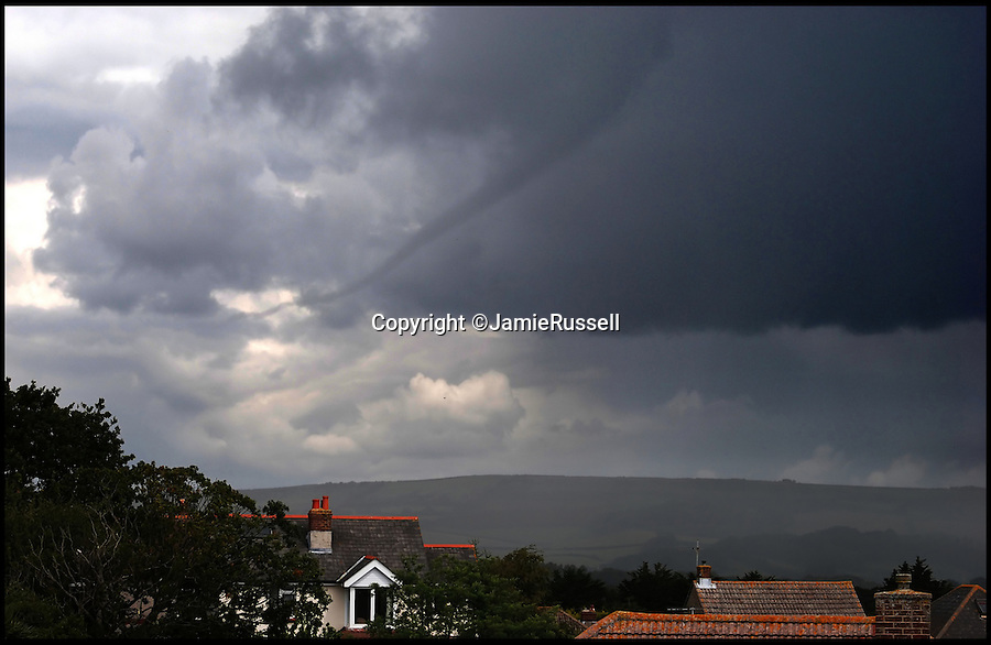 BNPS.co.uk (01202 558833)<br /> Pic: JamieRussell/BNPS<br /> <br /> ***Please Use Full Byline***<br /> <br /> A tornado over the Isle of Wight. <br /> <br /> Stunning photographs have revealed a turbulent side to the normally genteel Isle of Wight.<br /> <br /> The seemingly benign south coast holiday destination has been catalogued over a stormy year by local photographer Jamie Russell, and his astonishing pictures reveal the dramatic changes in weather that roll across the UK in just 12 months.<br /> <br /> Lightning storms, ice, floods, gales and blizzards have all been captured by the intrepid photographer who frequently got up in the middle of the night to capture the climatic chaos.<br /> <br /> Looking at these pictures prospective holidaymakers could be forgiven for thinking twice about a gentle staycation on the south coast island.