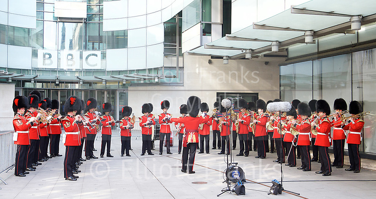 The Band of the Coldstream Guards outside the <br /> BBC, Broadcasting House, London, Great Britain <br /> 9th April 2017 <br /> <br /> The band of the Coldstream Guards <br /> playing &quot;Pacific&quot; live on BBC Radio 4 <br /> to promote the forthcoming St George's Day concert at Cadogan Hall, Chelsea on 22nd April 2017 in aid of Combat Stress <br /> <br /> Photograph by Elliott Franks <br /> Image licensed to Elliott Franks Photography Services