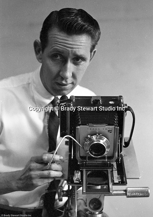 Pittsburgh PA:  Brady Stewart Studio photographer Dave VanDeVeer. Dave is posing for a photograph that was used in the Brady Stewart Studio advertisement at Ketchum McLeod and Grove offices - 1957. Dave was another very accomplished photographer at the studio and worked from 1952 through 1968.  After leaving Brady Stewart Studio, Dave opened his own successful photographic studio in Pittsburgh.