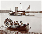 "Civil War: Double turreted Monitor Onondaga, on the James River, Virginia. Photo by Brady & Co. (Washington, D.C.) circa 1863. Sailors seated in rowboat coming ashore with the ""Onondaga,"" flag on stern, in the distance."