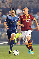Sporting Park, Kansas City, Kansas, July 31 2013:<br /> Michael Bradley (4) midfield AS Roma pursued by Omar Gonzalez.<br /> MLS All-Stars were defeated 3-1 by AS Roma at Sporting Park, Kansas City, KS in the 2013 AT &amp; T All-Star game.