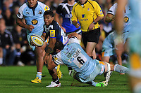 Kyle Eastmond looks to offload the ball after being tackled. Aviva Premiership match, between Bath Rugby and Northampton Saints on September 14, 2012 at the Recreation Ground in Bath, England. Photo by: Patrick Khachfe / Onside Images