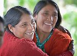 Teresa Diaz (left) hugs Julia Jimenez Miranda during a workshop at an eco-agricultural training center in Comitancillo, Guatemala. The center is sponsored by the Maya Mam Association for Investigation and Development (AMMID).