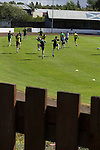 Harestanes AFC v Girvan FC, 15/08/2015. Scottish Cup preliminary round, Duncansfield Park. Home players taking part in their pre-match warm-up on the pitch before Harestanes AFC take on Girvan FC in a Scottish Cup preliminary round tie, staged at Duncansfield Park, home of Kilsyth Rangers. The home team were the first winners of the Scottish Amateur Cup to be admitted directly into the Scottish Cup in the modern era, whilst the visitors participated as a result of being members of both the Scottish Football Association and the Scottish Junior Football Association. Girvan won the match by 3-0, watched by a crowd of 300, which was moved from Harestanes ground as it did not comply with Scottish Cup standards. Photo by Colin McPherson.