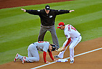 11 October 2012: Umpire Paul Emmel gives the safe sign at third during Postseason Playoff Game 4 of the National League Divisional Series between the Washington Nationals and the St. Louis Cardinals at Nationals Park in Washington, DC. The Nationals defeated the Cardinals 2-1 tying the Series at 2 games apiece. Mandatory Credit: Ed Wolfstein Photo