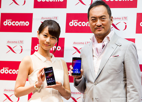 January 22, 2013, Tokyo, Japan - (L-R) Maki Horikita holding the 'Xperia Z SO-02E' smartphone and Ken Watanabe holding the 'ARROWS X F-02E' smartphone pose on stage during a NTT DOCOMO news conference in which the company announced their new line of products for the Japanese market. NTT DOCOMO presented their 2013 spring lineup of 12 models which includes 11 smartphones, tablets and a mobile Wi-Fi router. Photo by Christopher Jue/Nippon News)