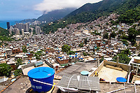 Rocinha, the largest slum in Brazil and one of the most developed in Latin America, built on a steep hillside overlooking the city of Rio de Janeiro, 28 February 2004.