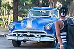 Havana, Cuba; a classic blue 1953 Pontiac convertible parked on the street in Old Havana
