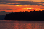 Sunrise over Blake Island. Blake Island State Park is a 475-acre marine camping park with five miles of saltwater beach shoreline providing magnificent views of the Olympic Mountains and the Seattle skyline. The park is only reachable by tour boat or private boat. Indian-style salmon dinners and demonstrations of Northwest Indian dancing are offered at Tillicum Village, a concession on the island. Jim Bryant Photo. ©2013. All Rights Reserved.