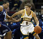 Seattle SuperSonics' Luke Ridnour drives against  Utah Jazz' Deron Williams in NBA basketball action in the period Friday, Nov. 17, 2006 in Seattle.  Jim Bryant Photo. &copy;2010. All Rights Reserved.