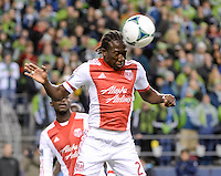 November, 2013: CenturyLink Field, Seattle, Washington: Portland Timbers midfielder Diego Chara (21) heads the ball  as the Portland Timbers take on the Seattle Sounders FC in the Major League Soccer Playoffs semifinals Round. Portland won the first match 2-1.