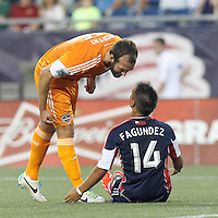 Houston Dynamo midfielder Adam Moffat (16) gives some advice to New England Revolution midfielder Diego Fagundez (14). In a Major League Soccer (MLS) match, Houston Dynamo (orange) defeated the New England Revolution (blue), 2-1, at Gillette Stadium on July 13, 2013.
