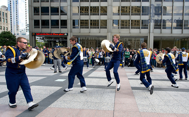 Oct. 6, 2012; Notre Dame Marching Band drummer's circle performance at Pioneer Court in Chicago before the Shamrock Series game. Photo by Barbara Johnston/University of Notre Dame..