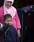 An Iraqi girl smiles as her younger brother gives a thumbs up to U.S. and Iraqi troops during a patrol in Mosul, Iraq. U.S. commanders say a string of new combat outposts and daily patrols by U.S. and Iraqi forces are pushing insurgents out of the city. March 1, 2008. DREW BROWN/STARS AND STRIPES