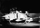 """United States Air Force RF-4 Phantom aircraft are maintained around the clock.  Above Airman First Class Elmer J. Schulte, 22, of Norway, Iowa, and Airman Second Class Jackson E. Ozment, 20, of Tribune, Kansas, prepare their """"bird"""" for a night reconnaissance mission over North Vietnam.  Both airmen were assigned to the 432nd Tactical Reconnaissance Wing.  .Credit: U.S. Air Force via CNP"""