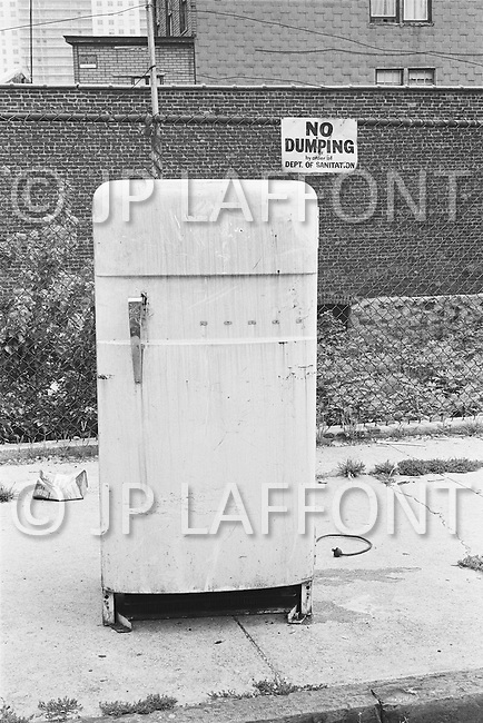 September 1967 --- Old Fridge in a New York City Street --- Image by © JP Laffont/Sygma/CORBIS