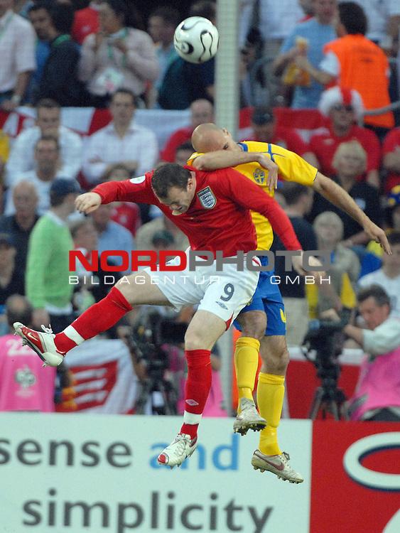 FIFA WM 2006 -  Gruppe B Vorrunde ( Group B )<br /> <br /> Play    #35 (20-Jun) - Schweden vs England <br /> <br /> <br /> <br /> Wayne Rooney (ENG) im Kopfballduell mit Teddy Lucic (SWE)<br /> <br /> <br /> <br /> Foto &copy; nordphoto