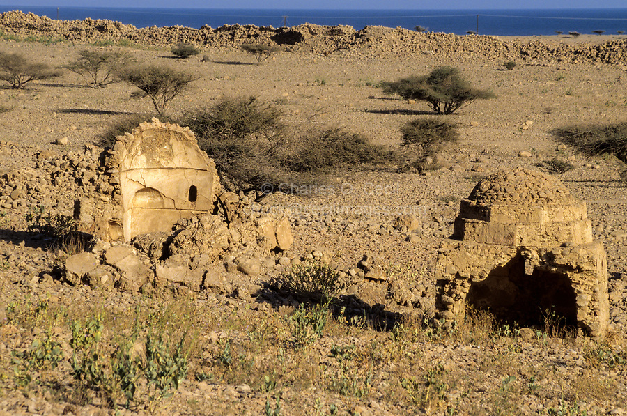 Qalhat, Oman.  Remains of Two Small Shrines; Remnants of City Wall in Background.