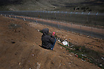 A kid near Israel-Syria border at the Druze village of Majdal Shams, during 'Land Day'.<br /> Israeli security forces were on high alert during 'Land Day', which is marked by Arabs to commemorate Arab land confiscations by Israel, as activists called for Arabs in Lebanon, Syria, Jordan and Egypt to march towards the borders with Israel.