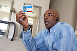 DNA Exonerated prisoner Thomas McGowan, in his home in Garland, Texas, holds his offender identification card.